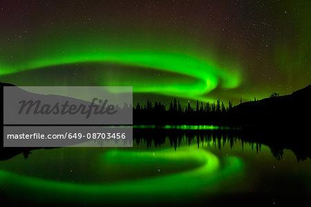 Aurora borealis over Polygonal Lakes area at night, Khibiny mountains, Kola Peninsula, Russia