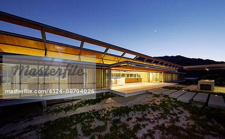 Illuminated modern luxury house at dusk