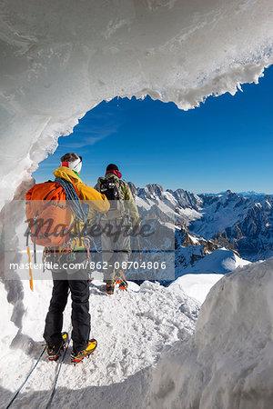 Europe, France, Haute Savoie, Rhone Alps, Chamonix, mountaineers at entrance to Aiguille du Midi arete