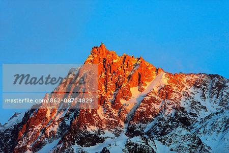 Europe, France, Haute Savoie, Rhone Alps, Chamonix, Aiguille du Midi sunset