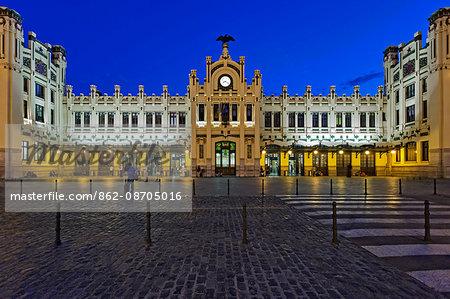 The front facade of the Estacio del Nord railway Station in Valencia at twilight, Xativa - Marques de Sotelo, Valencia, Comunidad Valenciana, Spain.