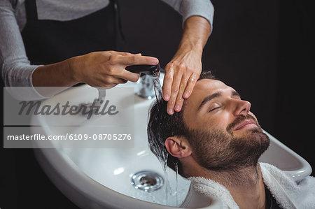 Man getting his hair wash at a salon