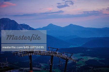 Ski lift and snow capped mountains, Austria