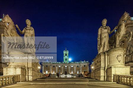 The Capitoline Hill,  Piazza della Campidoglio and the Comune  Di Roma, with the statues of Castor and Pollux at twilight, Rome, Lazio, Italy.