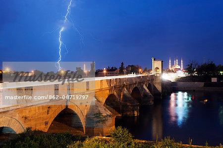 Turkey, Thrace, Edirne, Selimiye Camii mosque and Tunca Koprosu stone arched bridge