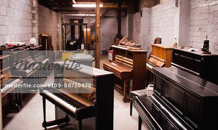 Pianos arranged in workshop