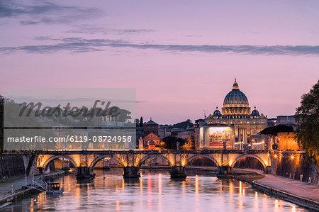 Dusk lights on Tiber River with bridge Umberto I and Basilica di San Pietro in the background, Rome, Lazio, Italy, Europe