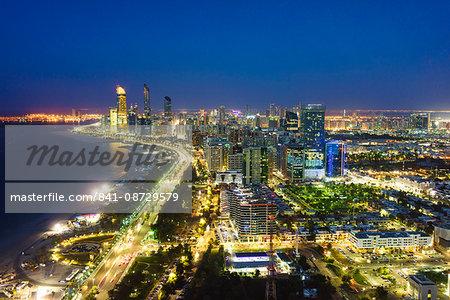 Skyline and Corniche, Al Markaziyah district by night, Abu Dhabi, United Arab Emirates, Middle East