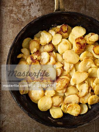 close up of rustic golden german pan fried potato bratkartofflen