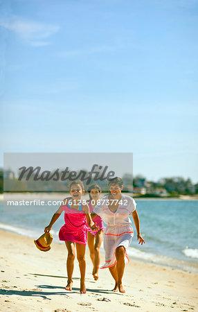Family enjoying time at beach.
