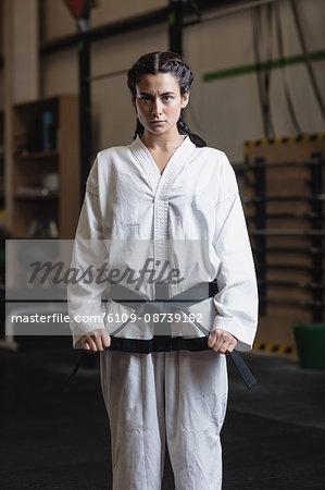 Portrait of woman in karategi at fitness studio