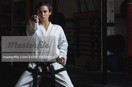 Man practicing karate in fitness studio