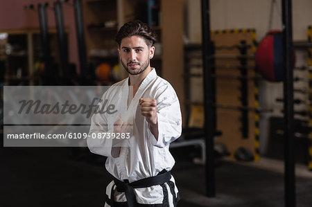 Portrait of man practicing karate in fitness studio