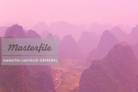 Karst landscape and haze, Yangshuo, Guangxi Province, China, Asia