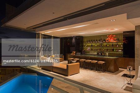 Luxury home showcase bar open to pool patio