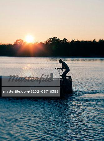 Man on ladder on jetty
