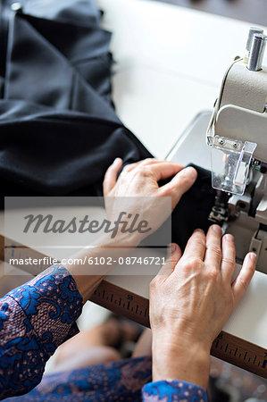Woman sewing, close-up