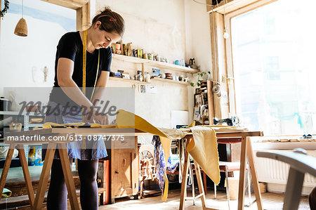 Seamstress Working In Her Workshop