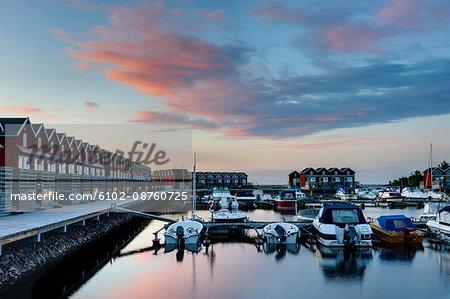 Boats moored at harbour, Sweden