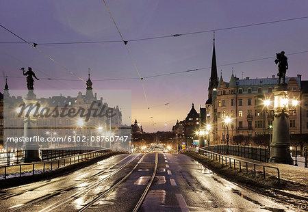 View of Djurgardsbron bridge at dusk, Stockholm, Sweden