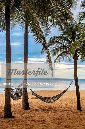 Hammocks hanging on beach, Thailand