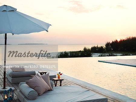 Sun chairs at swimming pool