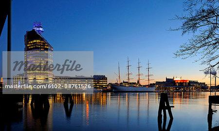 Tall ship moored at dusk