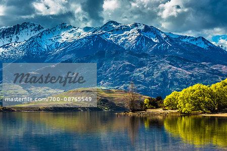 Shoreline of lake and mountain range at Glendhu Bay in the Otago Region of New Zealand