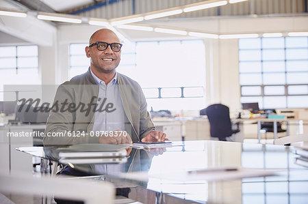 Smiling businessman listening in meeting