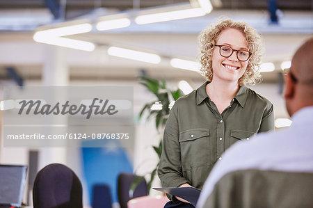 Businesswoman listening to businessman in meeting