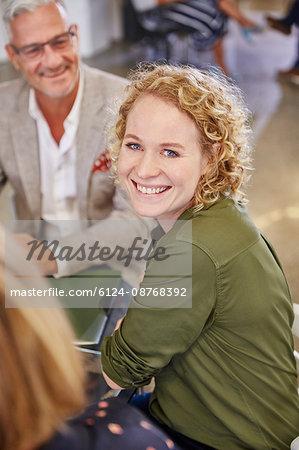 Portrait smiling businesswoman in meeting