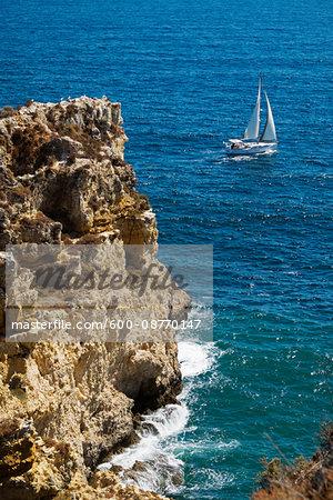Sailboat and Cliffs at Lagos, Algarve Coast, Portugal