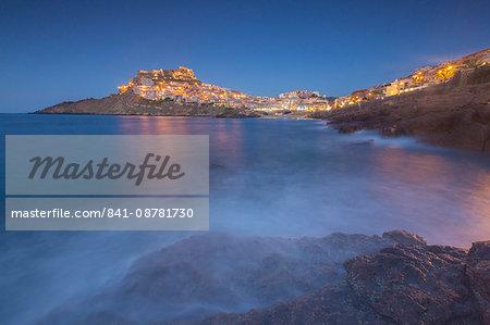 Waves frame the village perched on promontory at dusk, Castelsardo, Gulf of Asinara, Province of Sassari, Sardinia, Italy, Mediterranean, Europe