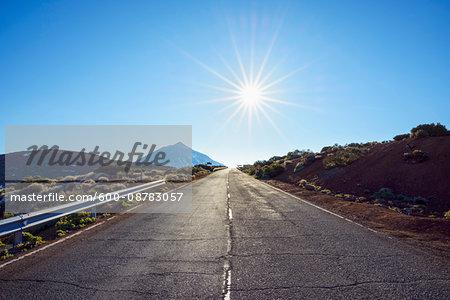 Road with Pico del Teide Mountain and Sun, Parque Nacional del Teide, Tenerife, Canary Islands, Spain
