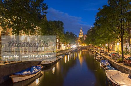 Spiegelgracht canal and Rijksmuseum at dusk, Amsterdam, Netherlands, Europe
