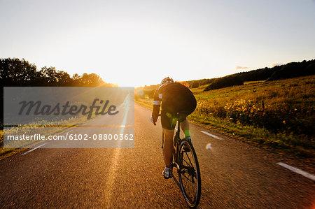 A woman riding a bike