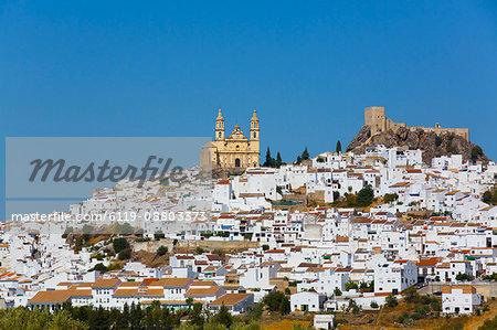 Nuestra Senora de la Encarnacion Church on the left and Arab Castle on the right, Olvera, Andalucia, Spain, Europe