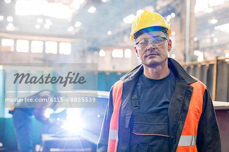 Portrait confident steel worker in factory