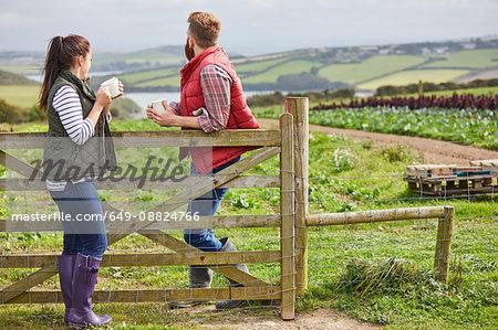 Couple on farm enjoying a hot drink
