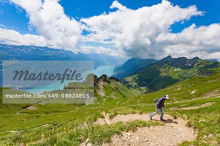 Man on mountain path, Brienzer Rothorn, Bernese Oberland, Switzerland
