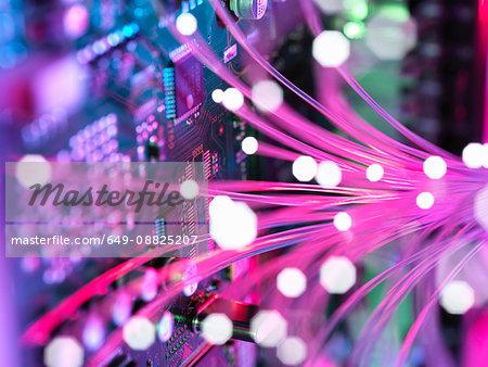 Cyber attack with fibre optics shooting past electronics of broadband hub