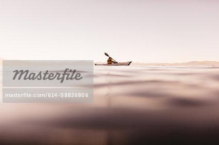 Woman kayaking on Lake Tahoe, California, USA
