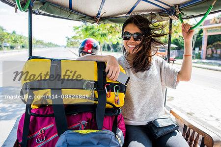 Woman riding in auto rickshaw, Siem Reap, Cambodia