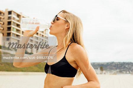 Woman drinking water from water bottle