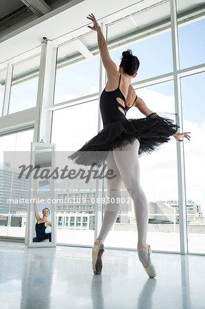 Ballerina practicing ballet dance in front of mirror