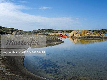 Kayak on rocky coast