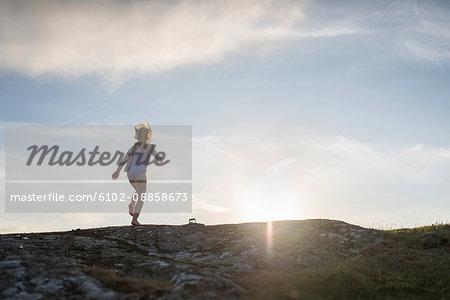 Girl running on rocks
