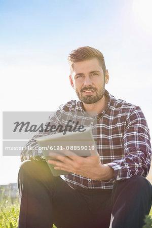 Young man using digital tablet, Munich, Bavaria, Germany