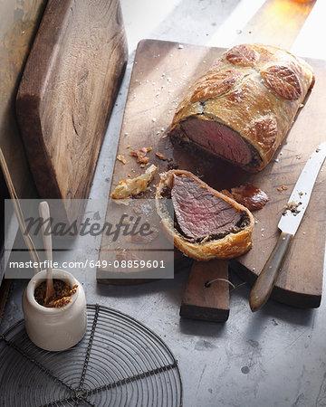 Beef wellington on cutting board