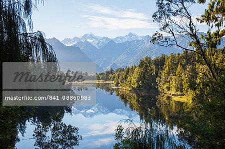 Mount Tasman and Aoraki (Mount Cook) reflected in Lake Matheson, Westland Tai Poutini National Park, UNESCO World Heritage Site, West Coast, South Island, New Zealand, Pacific